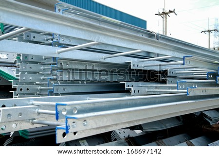 Steel ladders bunch on the rack in warehouse