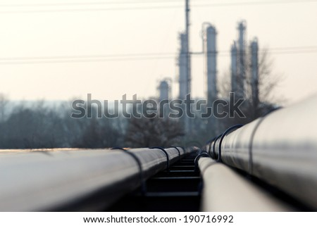 steel long pipes go to oil refinery - stock photo