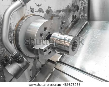 Steel metal automotive parts cutting machine process by CNC lathe in workshop
