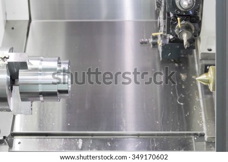 Steel metal cutting machine process by CNC lathe in workshop - stock photo