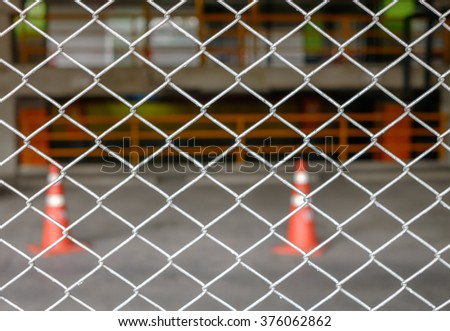 Steel metal fence with traffic cone background