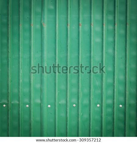steel metallic old rusty door, green grunge metal background - stock photo