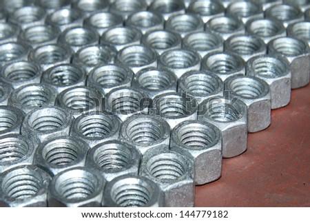 Steel nuts - stock photo