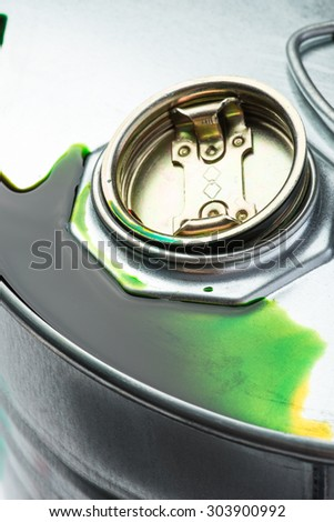 Steel oil and chemical drum over the white background with green pollution liquid, isolated - stock photo