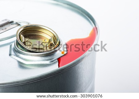 Steel oil and chemical drum over the white background with red pollution liquid, isolated - stock photo