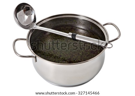 Steel pan with soup and ladle made of stainless steel, isolated on white background. - stock photo