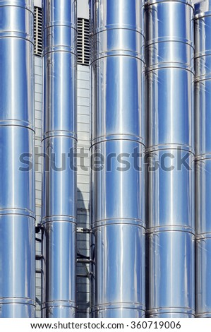 Steel pipes and pipelines abstract background. Modern industrial texture.