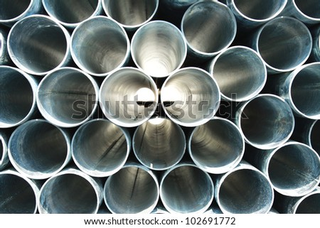 Steel pipes background - stock photo