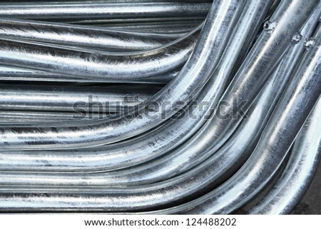 Steel pipes bunch in warehouse - stock photo