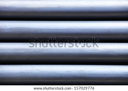 Steel pipes bunch in warehouse. - stock photo