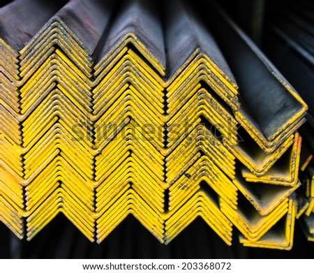 Steel Pipes bunch on the rack in warehouse - stock photo