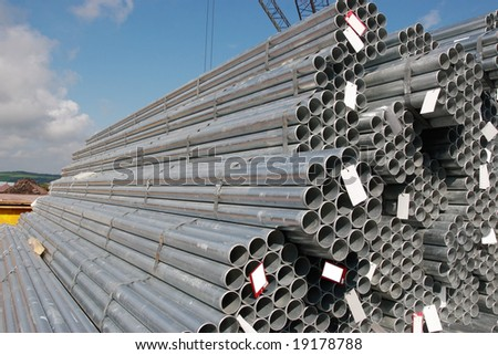 steel pipes on a dock in youghal ireland - stock photo
