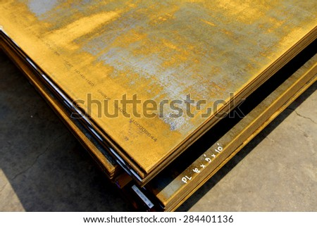 Steel plate bunch in warehouse - stock photo