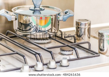 steel pot on the stove and salt shakers