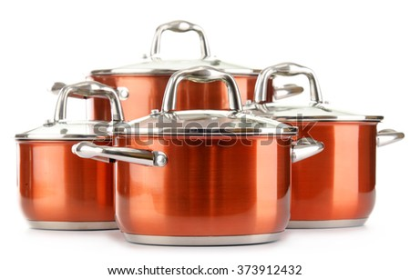 Steel pots isolated on white background. - stock photo