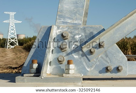 Steel power line pillar column support with bolts and nuts. - stock photo