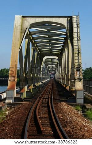 Steel railway bridge cross thee river - stock photo