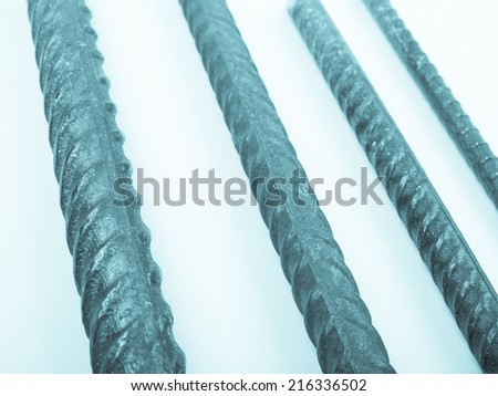 Steel reinforcing bars in different sizes for reinforced concrete construction - cool cyanotype - stock photo