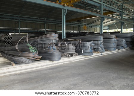 Steel rods or bars used to reinforce concrete, in warehouse - stock photo
