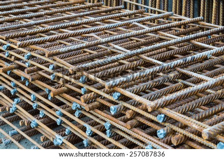 Steel rods placed in parallel used for construction - stock photo