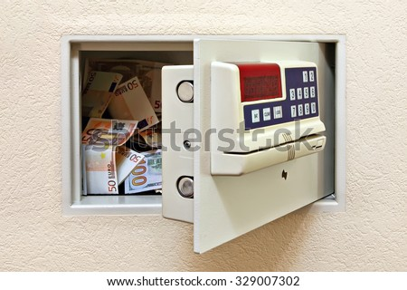 Steel safe with money - stock photo