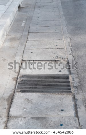 Steel Sewer Cover or Manhole cover, sewer grate on the floor - stock photo