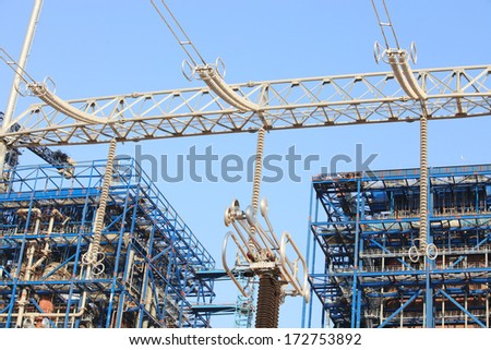 Steel structure of coal fire power plant and switch-yard gantry - stock photo