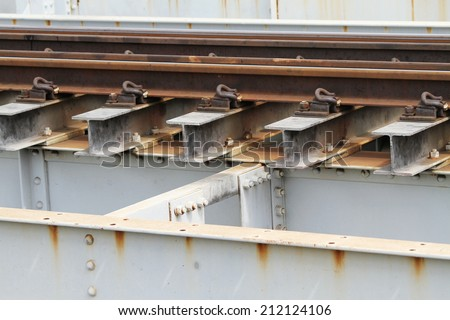 Steel supporting of rail way on steel bridge - stock photo