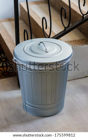 Steel trash cans beside the stairs - stock photo