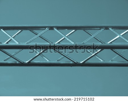 Steel truss beam structure over blue sky background - cool cyanotype - stock photo