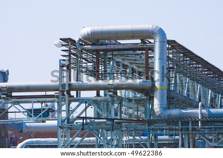 Steel tubular construction in summer with blue sky - stock photo