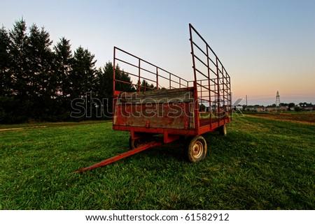 steel wagon on a grass field - stock photo