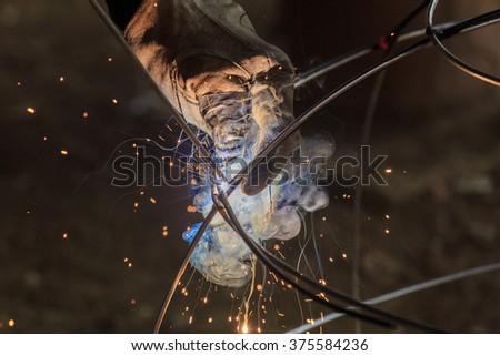 Steel welding, welding, welding machine - stock photo