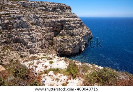 Steep cliff over Mediterranean sea on south part of Malta island - stock photo
