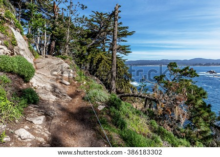 Steep & dangerous portion of North Shore Trail, in the background you see Bluefish Cove & coastline, at Point Lobos State Natural Reserve, along the rugged Big Sur coastline, Carmel and Monterey, CA.  - stock photo