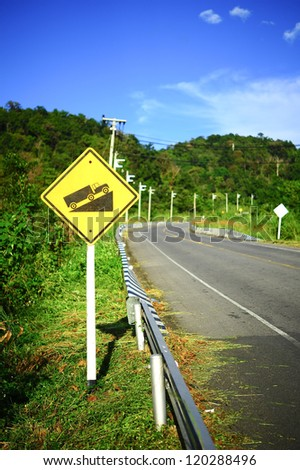 Steep grade hill traffic sign on road in thailand - stock photo