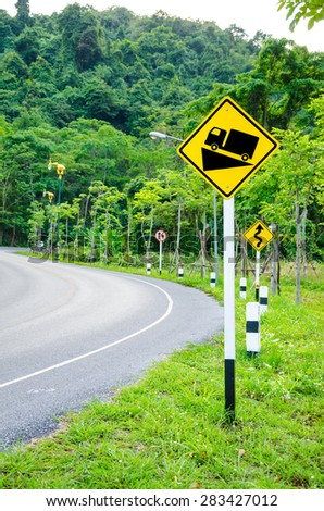 Steep grade warning sign on road to the mountain. - stock photo