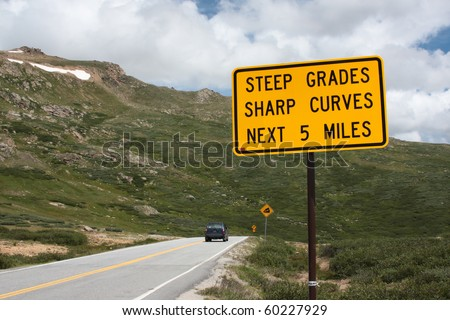 Steep grades and curves, road sign, dangerous road - stock photo