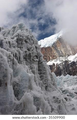 Steep ice wall at glacier tongue, Himalayas - stock photo