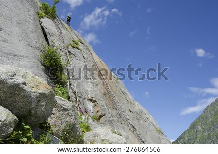 Steep ladders to the Mer de Glace glacier near Chamonix, French Alps - stock photo