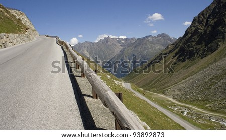 Steep road in the mountain - stock photo