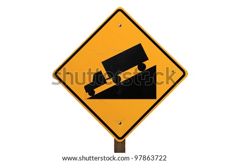 steep road sign with a truck driving down a steep downgrade in black and yellow on white background - stock photo