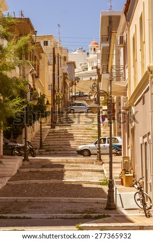 Steep stairs and narrow street in old town - stock photo