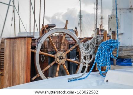 Steering wheel on sailboat. - stock photo