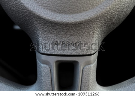 steering wheel with a integrated airbag - stock photo
