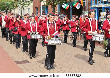 STEINHUDE, GERMANY - JULY 16, 2016: Marching band on a fair in Steinhude,North Germany, Europe. Near the city Hanover. It is the annual parade of the regional shooting association.