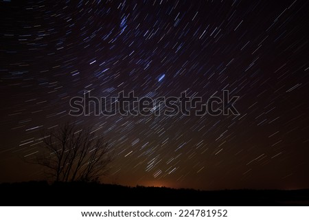 stellar tracks in the sky after sunset - stock photo