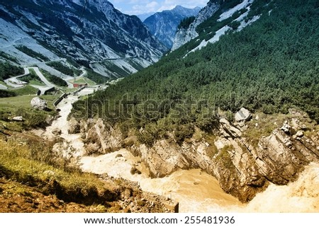 Stelvio National Park in Italy. Road to Stelvio Pass in Ortler Alps. Filtered style toned color. - stock photo