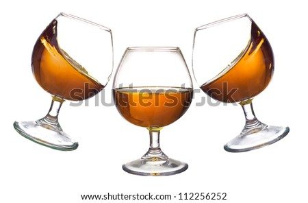 Stemware with cognac. Abstract drink composition - stock photo