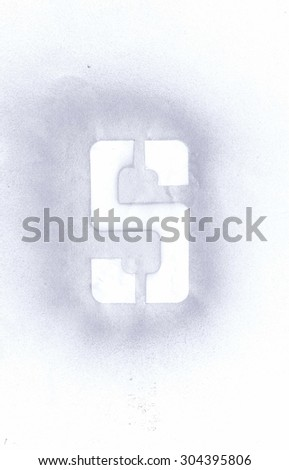 Stencil letter S sprayed with silver spray paint on white paper - stock photo